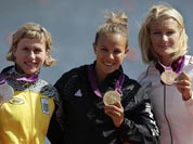 Winners of the women`s kayak single 200m pose at the podium in Eton Dorney, near Windsor, England, at the 2012 Summer Olympics.
