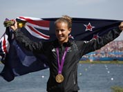New Zealand`s Lisa Carrington celebrates at the podium after winning the gold medal in the women`s kayak single 200m in Eton Dorney, near Windsor, England, at the 2012 Summer Olympics.