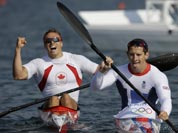 Great Britain`s Ed McKeever, right, paddles to the dock with Canada`s Mark de Jonge after winning the gold medal men`s kayak single 200m in Eton Dorney, near Windsor, England, at the 2012 Summer Olympics.