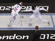 Hwang Woojin of South Korea, left, defeats Dennis Bowseher of the United States during the men`s fencing section of the modern pentathlon at the 2012 Summer Olympics.