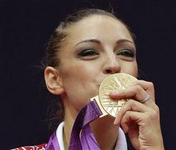Olympics 2012 gymnastics: Exquisite Kanaeva twirls for rhythmic gold