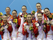 The team of China and winner of the silver medal poses during he medal ceremony for the women`s team synchronized swimming free routine at the Aquatics Centre in the Olympic Park during the 2012 Summer Olympics in London.
