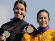 Gold medalist Mariana Pajon, of Colombia, poses for photographs with New Zealand`s Sarah Walker, silver medalist, and Laura Smulders, of the Netherlands, with the bronze medal for women`s BMX cycling during the 2012 Summer Olympics in London.