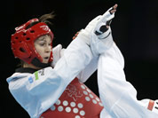 France`s Anne-Caroline Graffe fights Uzbekistan`s Natalya Mamatova (in red) during their match in women`s plus 67-kg taekwondo competition at the 2012 Summer Olympics in London.