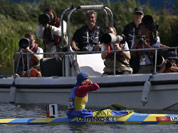 Ukraine`s Inna Osypenko-Radomska gestures to photographers after winning the silver medal in the women`s kayak single 200m in Eton Dorney, near Windsor, England, at the 2012 Summer Olympics.