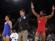 Yogeshwar Dutt of India reacts after beating Ri Jong Myong of North Korea for the bronze medal during the men`s 60-kg freestyle wrestling competition at the 2012 Summer Olympics in London