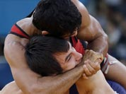 Sushil Kumar of India (in red) and Ramazan Sahin of Turkey, (in blue) compete during their 66-kg freestyle wrestling match at the 2012 Summer Olympics.