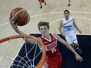 Russia`s Andrei Kirilenko (15) drives to the basket against Argentina during a men`s bronze medal basketball game at the 2012 Summer Olympics.