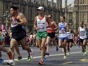 South Korea`s Kim Kwang-hyok runs near Big Ben during the men`s marathon at the 2012 Summer Olympics in London.