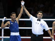 Cuba`s Robeisy Ramirez Carrazana reacts after being declared the winner over Mongolia`s Tugstsogt Nyambayar in their flyweight 52-kg gold medal boxing match at the 2012 Summer Olympics.