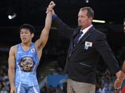 Tatsuhiro Yonemitsu of Japan celebrates after defeating Sushil Kumar of India, right, in the 66-kg freestyle wrestling gold medal match at the 2012 Summer Olympics.