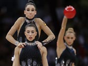 The team from Spain performs during the rhythmic gymnastics group all-around final at the 2012 Summer Olympics.
