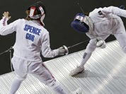 Britain`s Mhairi Spence, left, competes against Mexico`s Tamara Vega, right, during the fencing portion of the women`s modern pentathlon competition at the 2012 Summer Olympics.