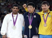 Silver medalist Sushil Kumar, gold medalist Tatsuhiro Yonemitsu of Japan, bronze medalist Akzhurek Tanatarov of Kazakhstan, and bronze medalist Livan Lopez Azcuy of Cuba, participate in the medals ceremony for men`s 66-kg freestyle wrestling at the 2012 Summer Olympics.