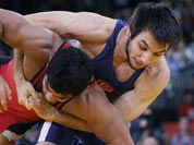 Sushil Kumar of India, competes with Ramazan Sahin of Turkey, (in blue) during their 66-kg freestyle wrestling match at the 2012 Summer Olympics.