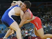 Jared Frayer of the United States, competes with Ali Shabanau of Belarus, (in blue) during their 66-kg freestyle wrestling match at the 2012 Summer Olympics.