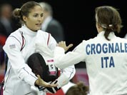 Elodie Clouvel from France, left, and Sabrina Grognale from Italy, right, shake hands after their bout during the fencing competition as part of the modern pentathlon at the Copper Box in the Olympic Park during the 2012 Summer Olympics.