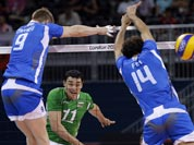 Bulgaria`s Vladimir Nikolov (11) follows his spike as it gets past Italy defenders Ivan Zaytsev (9) and Alessandro Fei (14) during a men`s volleyball bronze medal match at the 2012 Summer Olympics.