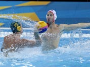 Billy Miller of Australia, left, shoots at goal as Layne Beaubien of the United States attempts to block during the men`s water polo seventh place match at the 2012 Summer Olympics.