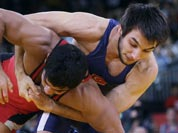 Sushil Kumar, competes with Ramazan Sahin of Turkey, (in blue) during their 66-kg freestyle wrestling match at the 2012 Summer Olympics.