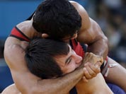 Sushil Kumar (in red) and Ramazan Sahin of Turkey, (in blue) compete during their 66-kg freestyle wrestling match at the 2012 Summer Olympics.