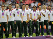 Mexico players stand on the podium with their gold medals during a ceremony following the men`s soccer final between Brazil and Mexico at the 2012 Summer Olympics in London