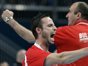 Bulgaria`s Teodor Salparov (13, front) and coach Nayden Naydenov react after scoring a point against Italy during a men`s volleyball bronze medal match at the 2012 Summer Olympics.