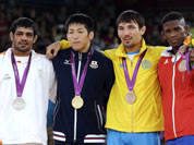 From left, silver medalist Sushil Kumar of India, gold medalist Tatsuhiro Yonemitsu of Japan, bronze medalist Akzhurek Tanatarov of Kazakhstan, and bronze medalist Livan Lopez Azcuy of Cuba, participate in the medals ceremony for men`s 66-kg freestyle wrestling at the 2012 Summer Olympics in London