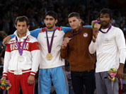 The medalists pose with their medals after the victory ceremony for the men`s 60-kg freestyle wrestling competition at the 2012 Summer Olympics in London. Seen from left to right are, Besik Kudukhov of Russia, Toghrul Asgarov of Azerbaijan, Coleman Scott of the United States and Yogeshwar Dutt of India