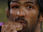 Bronze medalist Yogeshwar Dutt of India poses with his medal during the victory ceremony for the men`s 60-kg freestyle wrestling competition at the 2012 Summer Olympics.