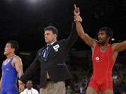Yogeshwar Dutt of India reacts after beating Ri Jong Myong of North Korea for the bronze medal during the men`s 60-kg freestyle wrestling competition at the 2012 Summer Olympics.