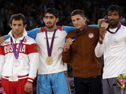 The medalists pose with their medals after the victory ceremony for the men`s 60-kg freestyle wrestling competition at the 2012 Summer Olympics.