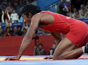 Yogeshwar Dutt of India celebrates after beating Ri Jong Myong of North Korea for the bronze medal during the men`s 60-kg freestyle wrestling competition at the 2012 Summer Olympics.