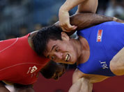 Yogeshwar Dutt of India competes against Ri Jong Myong of North Korea for the bronze medal during the men`s 60-kg freestyle wrestling competition at the 2012 Summer Olympics.
