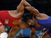 Franklin Gomez Matos of Puerto Rico competes against Yogeshwar Dutt of India (in blue) during the men`s 60-kg freestyle wrestling competition at the 2012 Summer Olympics.