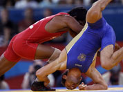 Besik Kudukhov of Russia competes against Yogeshwar Dutt of India (in red) during the men`s 60-kg freestyle wrestling competition at the 2012 Summer Olympics.