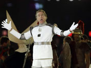 British comedian Eric Idle performs during the Closing Ceremony at the 2012 Summer Olympics, Sunday, Aug. 12, 2012, in London