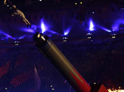 A performer is airborne during the Closing Ceremony at the 2012 Summer Olympics, Sunday, Aug. 12, 2012, in London.