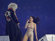 British singer Jessie J performs with Brian May, guitarist of the British rock band Queen, during the Closing Ceremony at the 2012 Summer Olympics, Sunday, Aug. 12, 2012, in London.