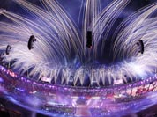This photo taken with a fisheye lens, pyrotechnics illuminate the sky above the Olympic Stadium during the Closing Ceremony at the 2012 Summer Olympics.