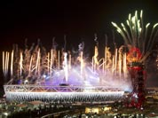 Fireworks explode over the Olympic Stadium at the closing ceremony of the 2012 Summer Olympics.