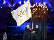 The Olympics flag is handed from London Mayor, Boris Johnson, second from left, to the International Olympic Committee President Jacques Rogge, as the Mayor of Rio de Janeiro, Eduardo Paes, right, watches during the Closing Ceremony of the 2012 Summer Olympic.