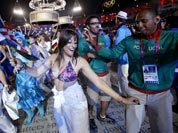 Portugal`s Nuno Delgado, dances with performers during the Closing Ceremony at the 2012 Summer Olympics in London.
