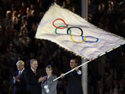 Rio de Janeiro mayor Eduardo Paes waves the olympic flag next to Jacques Rogge and London Mayor Boris Johnson, left, during the Closing Ceremony at the 2012 Summer Olympics, Sunday, Aug. 12, 2012, in London.