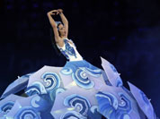 An artist performs during the Closing Ceremony at the 2012 Summer Olympics, Sunday, Aug. 12, 2012, in London. 