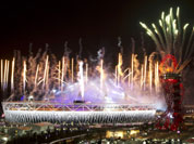 Fireworks explode over the Olympic Stadium at the closing ceremony of the 2012 Summer Olympics, Monday, Aug. 13, 2012, in London.