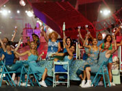 Performers cheer during the Closing Ceremony at the 2012 Summer Olympics, Sunday, Aug. 12, 2012, in London. 
