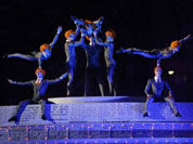 Acrobats perform on stage during the Closing Ceremony at the 2012 Summer Olympics, Sunday, Aug. 12, 2012, in London.