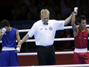 Devendro Singh Laishram, reacts after defeating Honduras` Bayron Molina Figueroa during a light flyweight 49-kg preliminary boxing match at the 2012 Summer Olympics in London