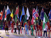 Flag bearers march in Olympic Stadium during the Closing Ceremony at the 2012 Summer Olympics, Sunday, Aug. 12, 2012, in London.